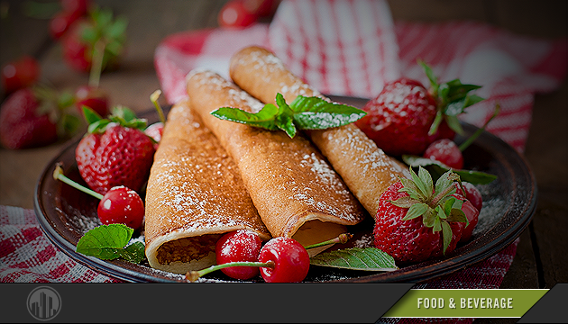Photo of pancakes and fruit on a plate. Login to find savings on food & beverages.